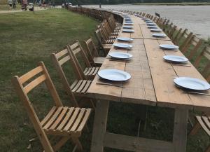long table beside river