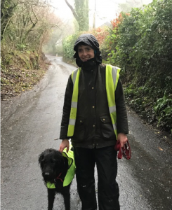 Liz walking in the rain with her dog