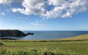 Blue skies and blue seas - overlooking headland in cornwall